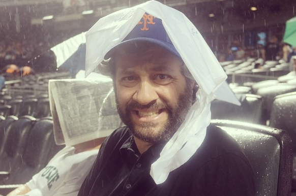 Judd Apatow Suffers Through Rain at Mets' Game
