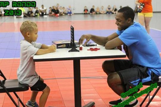 Rondo Takes Break at Camp to Play Connect Four