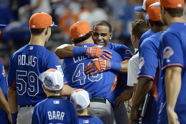 Bartolo Colon Embraces Yoenis Cespedes and Smacks Robinson Cano's Kid