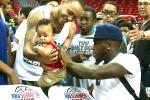 Seriously: Nate Robinson Signs a Baby at Summer-League Game