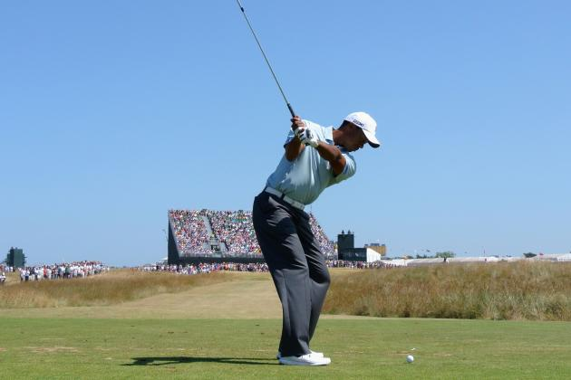 Tiger Woods Moves Up Leaderboard at British Open, Jokes with Media