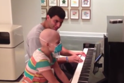 Video: Memphis' QB's Emotional Duet with 11-Year Old Cancer Patient