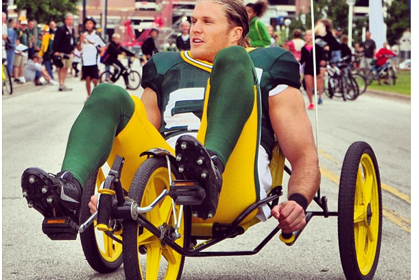 The Green Bay Packers Ride Kids' Bikes to Work