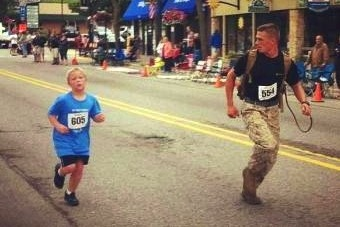 Charity 5K Is Scene for Beautiful Moment as Marine Helps Young Boy Finish