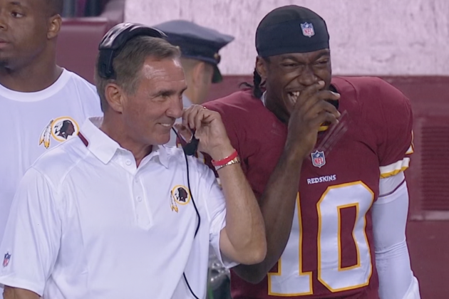 Redskins Coach Mike Shanahan Jokes with Robert Griffin III on the Sidelines