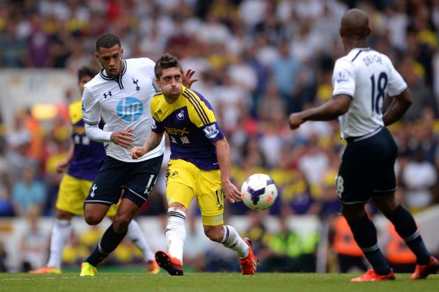 Smashmouth Spurs Sink Swansea with Powerful Midfield Performance