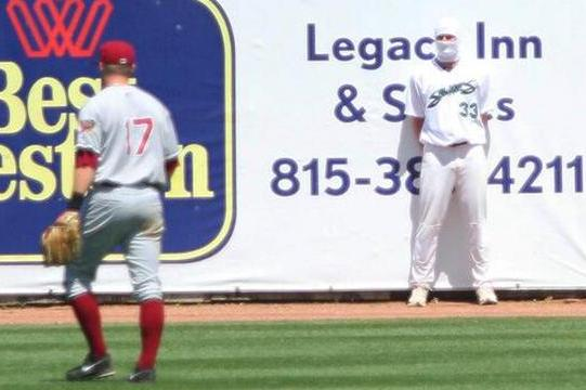 Minor League Ninja Blends into the Outfield Wall During Games