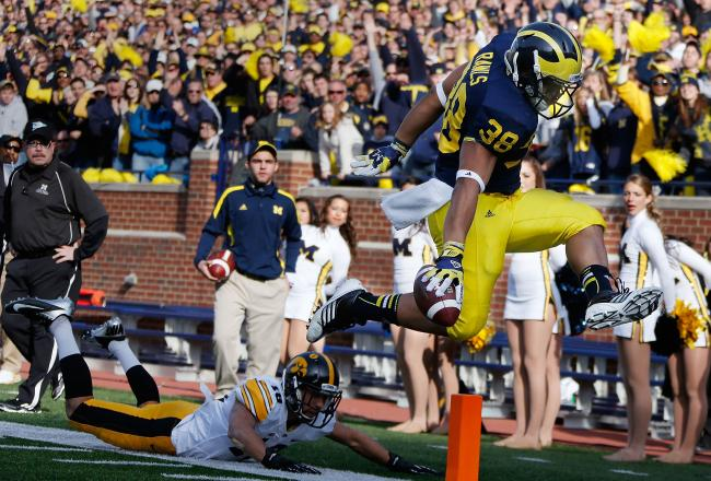 Thomas Rawls punches one in the end zone (photo from vs. Iowa, 2012)