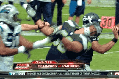 Panthers' Frank Alexander Gets Ejected for Punching Seahawks' Breno Giacomini