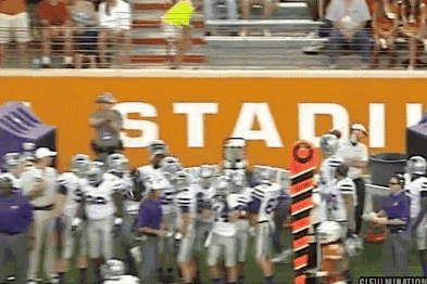 Texas QB David Ash Throws Ball Away and Smacks K-State Staffer in the Face