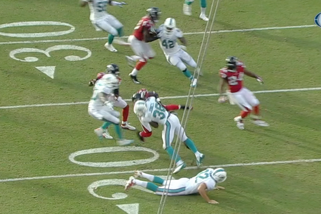 Dolphins' Don Jones Forces Fumble with a Big Hit on Falcons' Harry Douglas