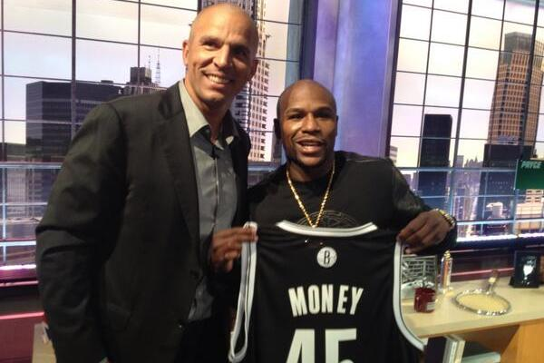 Floyd Mayweather Holds Up New Nets Jersey
