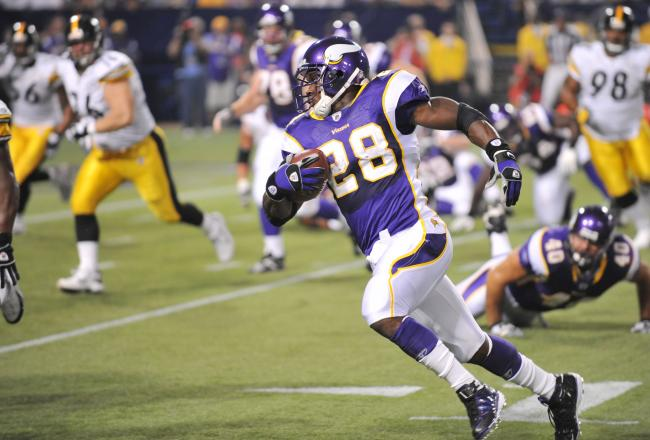 Hi-res-82530463-adrian-peterson-of-the-minnesota-vikings-carries-the_crop_north