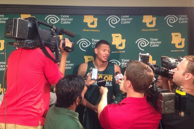 Isaiah Austin Surrounded by Media on Media Day
