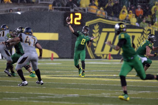 Mariota throwing down the field to Addison.