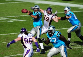 130976933-cam-newton-of-the-carolina-panthers-passes-against-the_crop_north