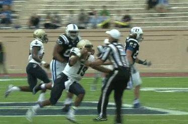 Navy Quarterback Keenan Reynolds Shoves Ref to Ground with Stiff Arm