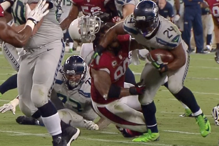 Marshawn Lynch Goes Full Beast Mode as He Knocks off Darnell Dockett's Helmet