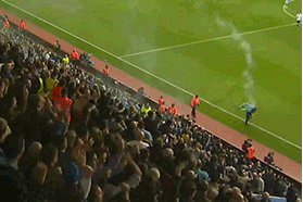 GIF: Fan Throws Flare, Hits Linesman at Aston Villa vs. Tottenham