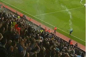 GIF: Fan Throws Flare, Hits Linesman at Aston Villa vs. Tottenham