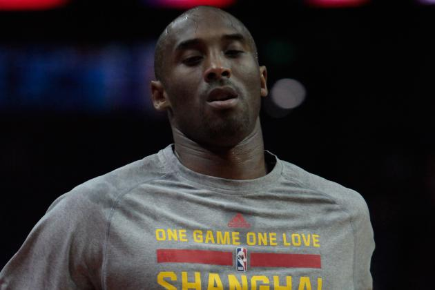 KOBE BRYANT RISKS MOST VALUABLE HAND  ... to Pet a LION!!!