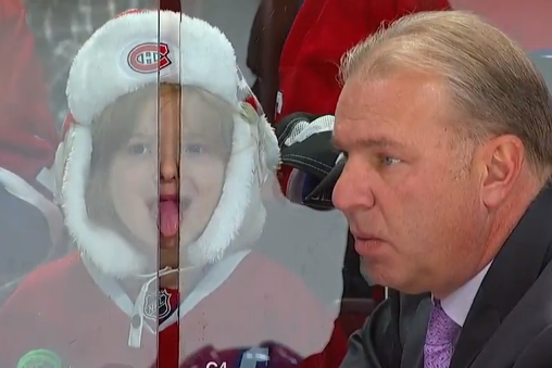 Young Girl Sticks Tongue in Between Glass During NHL Game
