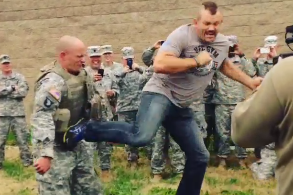 Chuck Liddell Knocks Wind out of (Willing) Armored Soldier with Back Kick