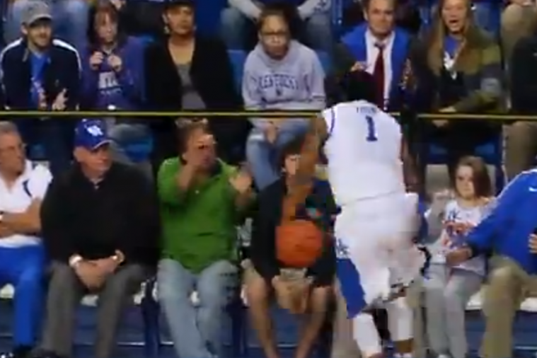 Kentucky's James Young Tries to Save the Ball, Scores on His Own Team's Basket