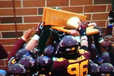 Gophers Excitedly Break Governor's Victory Bell Trophy