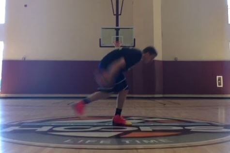Watch as a Guy Nails Incredible Scoop Shoot from Half Court