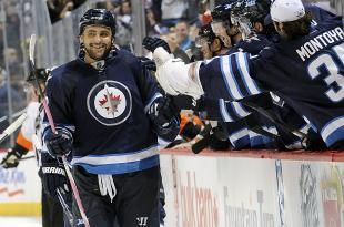 Hi-res-188142931-dustin-byfuglien-of-the-winnipeg-jets-celebrates-his_crop_north
