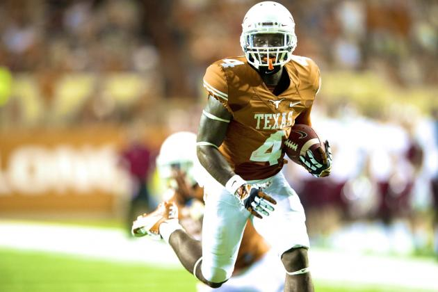 Texas Suspends Daje Johnson and Chet Moss for Violating Team Rules