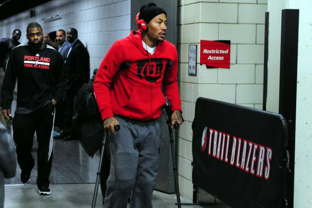 Bulls Watch NBA Title Chances Limp Away with Derrick Rose Injury