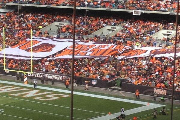 Cleveland Browns 'Dawg Pound' Fans Hold Banner Upside Down