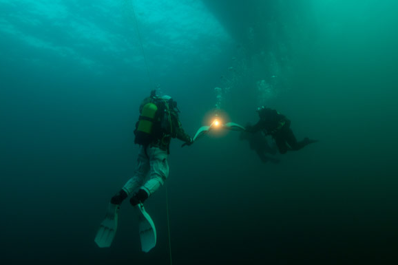 Olympic Flame Carried Underwater in World's Deepest Lake
