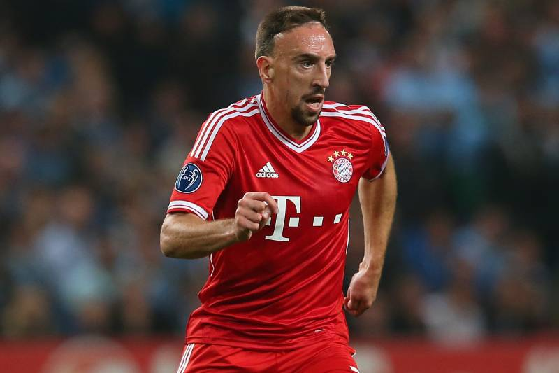 Franck ribery belittles cristiano ronaldo mask gesture by real manchester england october 02 franck ribery of muenchen in action during the uefa voltagebd Images