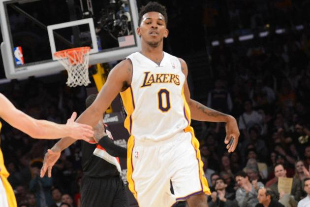Nick Young Throws Down Monster Reverse Dunk over Joel Freeland
