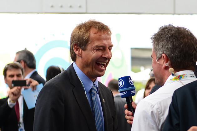 Jurgen Klinsmann Queues Up to Buy Merchandise Before 2014 World Cup Draw