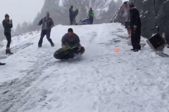 Oregon Ducks Football Players Ride Inner Tubes in the Snow