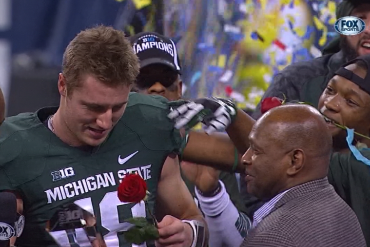 Ohio State's 2-Time Heisman Winner Hands Trophy to Michigan State Players