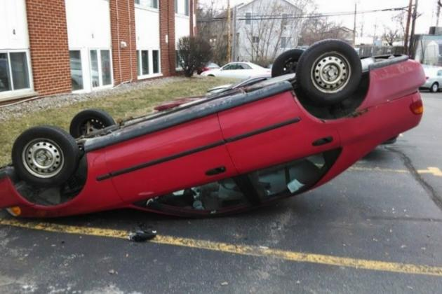 Michigan State Football: Students Fund Flipped-over Car