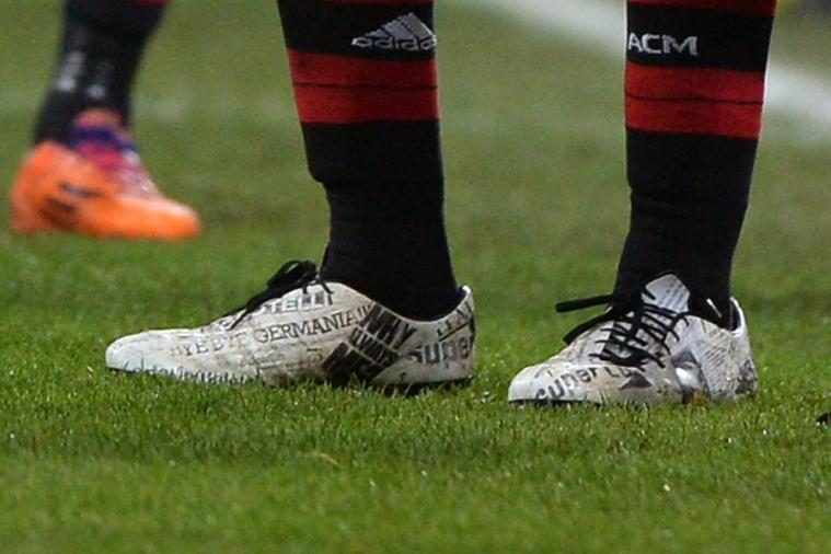 Mario Balotelli Wears Football Boots Covered in Headlines He Has Made