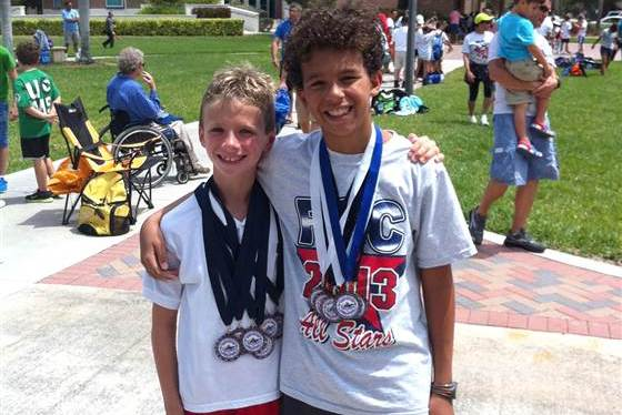Young Swim Champ Displays Amazing Act of Sportsmanship to Hospitalized Rival