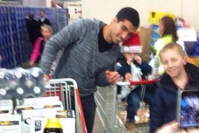 Luis Suarez Celebrates New Liverpool Deal at Costco with a Trolley of Corona