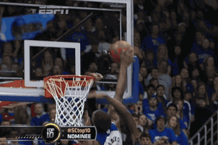 Kansas Center Joel Embiid Stuffs Aaron Bowen at the Rim