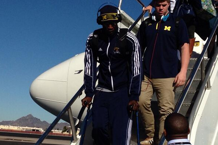 Devin Gardner Gets off Plane with Boot & Crutches