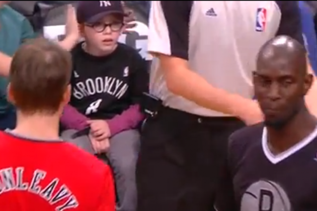 Little Courtside Fan Gets 'Earmuffs' Treatment for Protection from Kevin Garnett