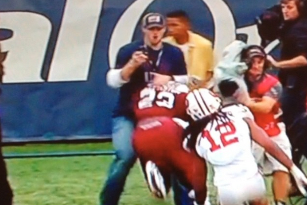 Sideline Fan at Capital One Bowl Gets Trucked While Filming Cellphone Video