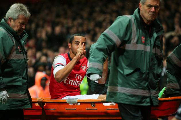 Arsenal's Theo Walcott Gives Spurs Fans a 2-0 Sign as He Leaves on Stretcher
