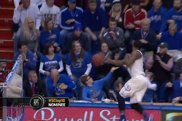 Kansas' Wayne Selden Dives into Crowd to Save Ball, Jayhawks Score on Play